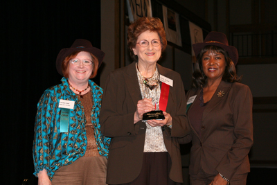 Ann McNair, center, is presented with the 2011 Technology