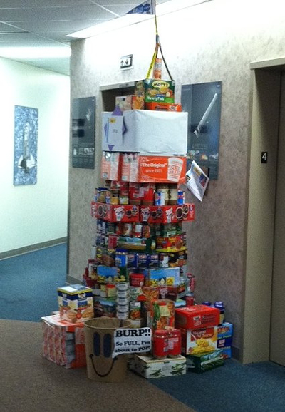 Competition within the Propulsion Systems Department led to towers of food cropping up outside conference rooms and elevators in Building 4203. Feed Me, the collection-bin mascot of this year�s campaign, was on-hand to survey the results.