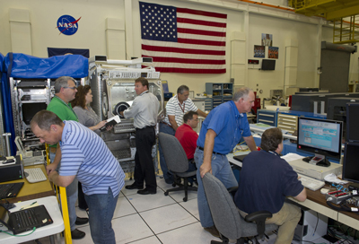 The Marshall Center integrates and tests payloads in an identical engineering model of the Microgravity Science Glovebox to make sure hardware is working smoothly before it is sent to the International Space Station.