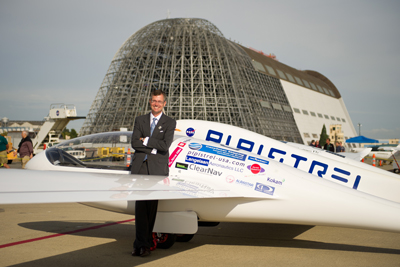 Pipistrel-USA team lead Jack Langelaan shows off the winning aircraft, the Taurus G4, on Oct. 3 at NASA's Ames Research Center. The all-electric airplane achieved the equivalency of more than 400 miles per gallon.