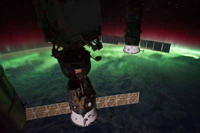 Two Russian Soyuz spacecrafts are backlit by an auroral display in this picture taken from the International Space Station on Sept. 17.