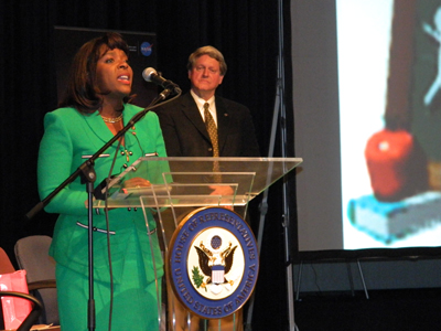 U.S. Rep. Terri Sewell of Alabama, left, host of the in-flight educational event, welcomes students as Marshall Center Deputy Director Gene Goldman looks on.