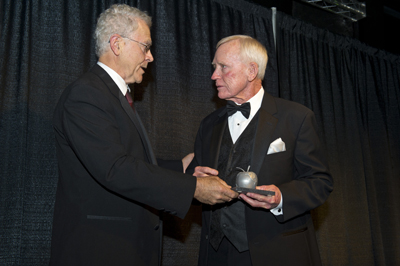 Dr. Frank Six, right, university affairs officer and assistant manager of the Marshall Space Flight Center's Academic Affairs Office, receives the Dr. Wernher von Braun Aerospace Educator Award from author and former NASA aerospace engineer Homer Hickam at the 23rd Annual Dr. Wernher von Braun Memor