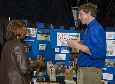 Sherresa Lockett, left, with Deltha-Critique supporting the Science and Technology Department, learns more about the Downtown Rescue Mission in Huntsville from Corey Buckner, development coordinator for the nonprofit organization.