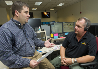 Jason Norwood, left, a payload operations director at the Marshall Center, goes over procedures with NASA astronaut TJ Creamer during one of his training sessions in the Payload Operations Center.