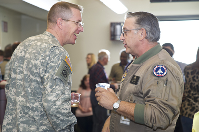 Col. John Hamilton, left, thanks Ralph Young -- an Air Force veteran who is a technician in the Engineering Directorate -- for his service.