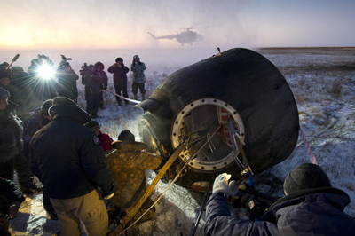 Russian support personnel work to get crew members out of the Soyuz TMA-02M spacecraft shortly after the capsule landed with Expedition 29 Commander Mike Fossum and Flight Engineers Sergei Volkov and Satoshi Furukawa in a remote area outside of the town of Arkalyk, Kazakhstan, on Nov. 21.