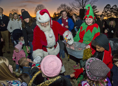 Santa and his cheerful helper hand out treats to children at the Marshall Space Flight Center's rocket-lighting ceremony Dec. 1.