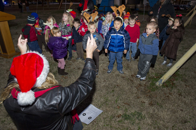 Children from Marshall's Child Development Center sing holiday classics, including
