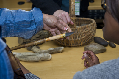 Marshall team members examine tools and artifacts discovered by Ben Hoksbergen and his team on Redstone Arsenal.