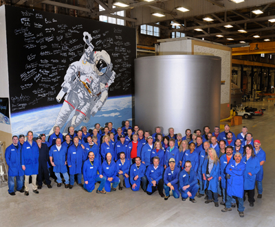 The Alliant Techsystems Inc. Component Refurbishment Center crew with the final piece of case hardware processed under the space shuttle reusable solid rocket motor program.
