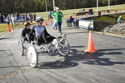 Racers from the University of Puerto Rico in Humacao speed to first place -- for the second year in a row -- in the college division of the 18th annual NASA Great Moonbuggy Race, held April 1-2 at the U.S. Space & Rocket Center in Huntsville.