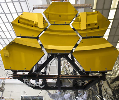 Marshall engineers and technicians guide six mirror segments of the James Webb Space Telescope off the rails of the vacuum chamber after completing final cryogenic testing.
