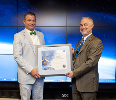 Dr. Jonathan Cirtain, left, receives the PECASE award from Chuck Gay, Acting Associate Administrator for NASA's Science Mission Directorate.