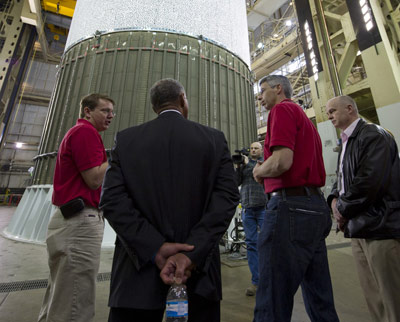 Mark Hilburger, left, talks with NASA Administrator Charles Bolden, center left, as he toured Marshall's Engineering Test Laboratory.