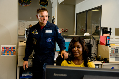 International Space Station astronaut Doug Wheelock, with assistance from Payload Communicator Reagan Malone, talks to the crew aboard the station during his visit to the Marshall Center April 11.
