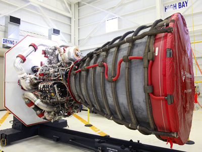 A RS-25D engine in the Engine Processing Facility at Kennedy is awaiting placement in a transportation canister for shipment to Stennis.