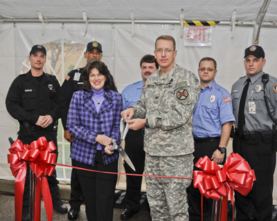 Marshall Associate Director Robin Henderson and Redstone Garrison Commander Col. John Hamilton cut the ribbon in front of the Joint 911 Dispatch Center in Building 4312.