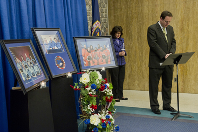 Marshall Space Flight Center Director Robert Lightfoot, right, and Associate Director Robin Henderson, center, pause for a moment of silence during the Jan. 26 Day of Remembrance Ceremony in the lobby of Building 4200.
