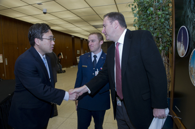Robert Lightfoot, right, director of the Marshall  Center, greets Dr. Eun Kim, left, chief engineer for the Affordable Upper Stage Engine Program for Aerospace Corp., and Capt. Chris McGraff, center, deputy of the Affordable Upper Stage Engine Program for the Air Force.