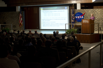 Mindy Niedermeyer, chair of the Space Launch System Advanced Development NASA Research Announcement, addresses more than 115 people representing 48 companies and universities during the SLS Advanced Development Industry and Academia Day on Feb. 14.