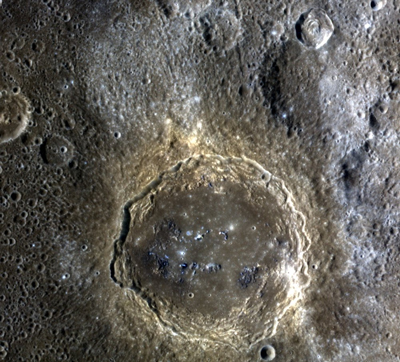 Firdousi crater on Mercury, with blue halos of ejecta.