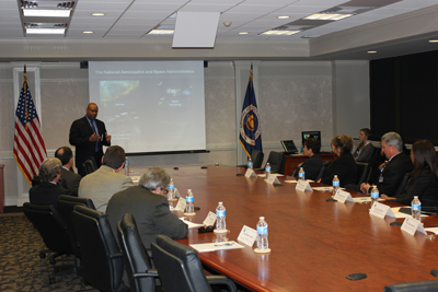 Bobby Watkins, standing, director of the Marshall Space Flight Center's Office of Strategic Analysis & Communications, presents a center overview to Chamber of Commerce of Huntsville/Madison County representatives, who visited the center March 1.
