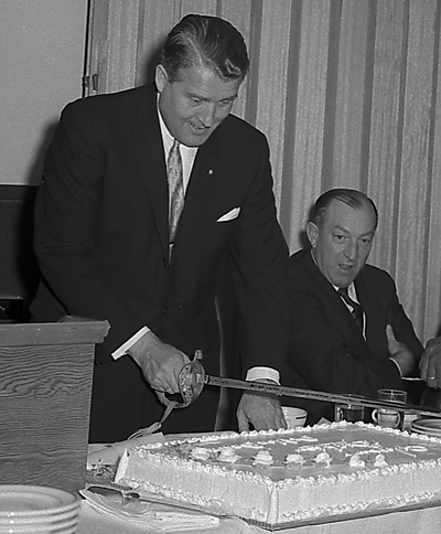 Von Braun cuts a cake to celebrate his 50th birthday in 1962. Looking on is U.S. Rep. Robert Jones of Alabama.