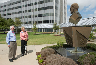 Von Braun's daughter, Iris Robbins, right, visits the statue of her father, located at Building 4203. Marshall Historian Mike Wright is at left.