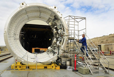 A technician with ATK of Brigham City, Utah, makes final adjustments prior to the March 28 Flight Control Test 1, testing the avionics and controls for NASA�s Space Launch System booster.