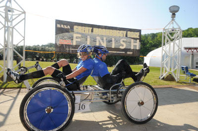 The University of Alabama in Huntsville Team 1 crosses the finish line at the NASA Great Moonbuggy Race. UAHuntsville took the top prize in the college division, with a time of 4 minutes and 3 seconds. The race is organized and planned each year by the Marshall Center.