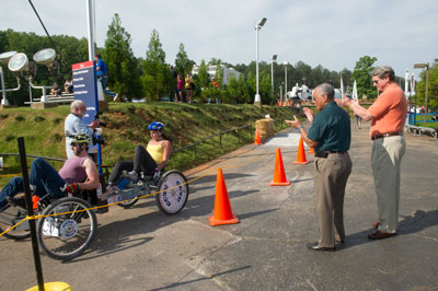 NASA Administrator Charles Bolden, second from right, and Marshall Center Acting Director Gene Goldman, right, cheer on a team from Central Connecticut State University in New Britain on the second day of the moonbuggy race.