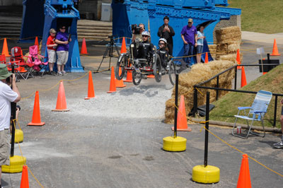 International Space Education Institute Team 1 of Leipzig Saxony, Germany, goes airborne over an obstacle at the NASA Great Moonbuggy Race.