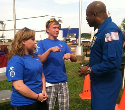 Leland Melvin, right, associate administrator for the Office of Education at NASA Headquarters, and a former astronaut, visits with one of the moonbuggy teams from Bevill State Community College in Sumiton, Ala.