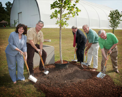 Digging in for the annual tree planting are, from left, Robin Henderson, Steve Doering, Gene Goldman, Steve Cash and Ed Kiessling.