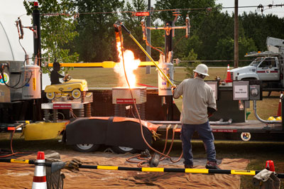 A representative from Huntsville Utilities gives a fiery demonstration on energy awareness at SHE Day. Other activities and exhibits included a self-defense class and a HEMSI search-and-rescue dog demonstration.