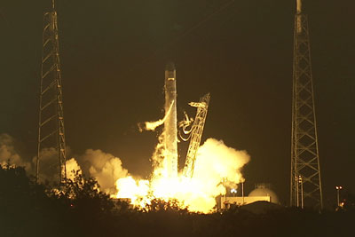 The SpaceX Falcon 9 rocket lifts off from Space Launch Complex-40 at Cape Canaveral Air Force Station, Fla., to begin a demonstration flight.