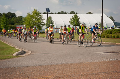 More than 150 cyclists get off to a 'wheelie' good start from the Building 4315 NASA Wellness Center parking lot for the Tour d'Arsenal.