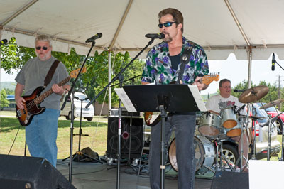 The music group Nuthin Fancy, which includes Marshall team members Pete Allen and Louie Clayton, perform classic rock tunes at the picnic.