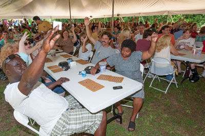 B-I-N-G-O! Players raise their hands to get in on the next round of bingo, one of the most popular activities at the picnic. Several lucky winners went home with iPads, flat-screen televisions, portable generators and other great prizes.