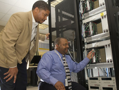 Markeeva Morgan, left, avionics hardware lead for SLS Core Stage element office, and Walter Robinson, command and data handling hardware lead of the Data Systems Development Team, integrate the software test beds into the laboratory.