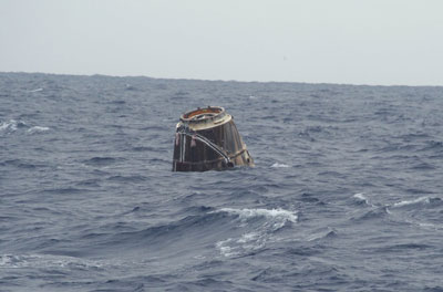 The SpaceX Dragon cargo vehicle floats in the Pacific Ocean after splashdown.