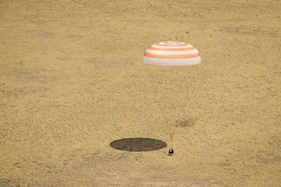 The Soyuz TMA-03M spacecraft is seen as it lands with Expedition 31 Commander Oleg Kononenko of Russia and Flight Engineers Don Pettit of NASA and Andre Kuipers of the European Space Agency in a remote area near the town of Zhezkazgan, Kazakhstan, on July 1.