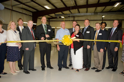 Avans Machine & Tool employees, with representatives from NASA and Pratt & Whitney Rocketdyne, cut the ribbon at their recently expanded Scottsboro facility July 11.