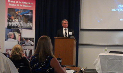 The Marshall Space Flight Center recently participated in the Maine Aerospace Alliance's NASA Industry Day event in Brunswick, Maine. David Brock, Marshall's small business specialist in the Office of Procurement, left, discusses how government and contracting agencies can market to NASA.