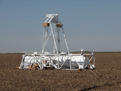 A balloon-borne gondola bearing NASA's original HERO science mission lands safely in a Kansas field in 2005. The new HEROES flight project builds on that successful mission.