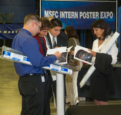 A group of interns joins more than 150 other interns during the Intern Poster Expo on Aug. 1, where they showcased the research work they supported at Marshall over the summer.
