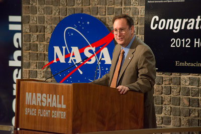 The Marshall Space Flight Center honored more than 300 employees and contractors during its Annual Honor Awards ceremonies Aug. 16. Right, NASA Acting Associate Administrator Robert Lightfoot delivers the keynote address to a standing-room-only auditorium during the events.