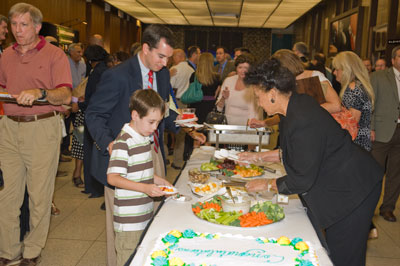 Awards recipients and their families are treated to hors d'oeuvres and cake following the ceremonies.