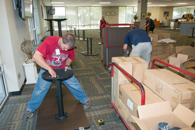 Workers are assembling the new furniture for Marshall team members to enjoy during their lunch breaks. Booths are expected to arrive Sept. 14.